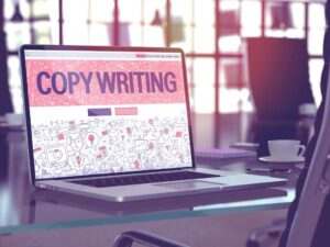 Copywriting Concept. Closeup Landing Page on Laptop Screen in Doodle Design Style. On Background of Comfortable Working Place in Modern Office. Blurred, Toned Image. 3D Render.